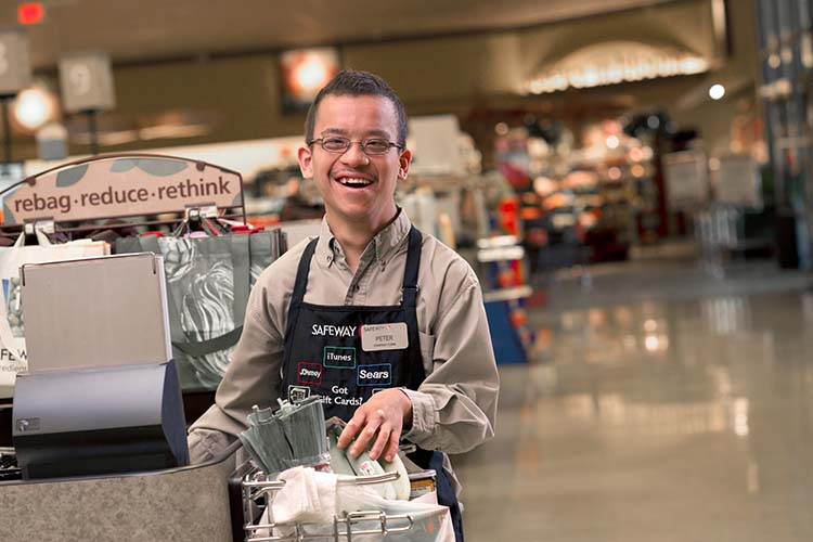 A man with developmental disability working in a grocery store.